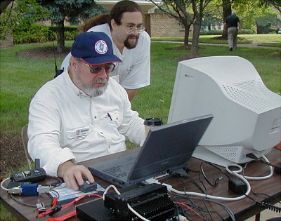 APRS Node by Dave Putman - KG4KZZ with Allon Stern - KE4FYL assisting. Photo by Norm Styer - AI2C.